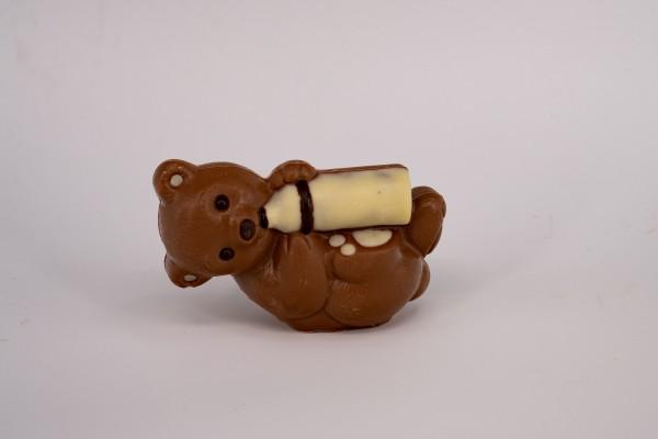 Schokoladenfigur Bär liegend